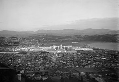 12; Elevated view Centennial Exhibition and Lyall Bay at night - Circa 1940 (Wellington City Council) Tags: wellington historicwellington 1800s 1900s 1950s