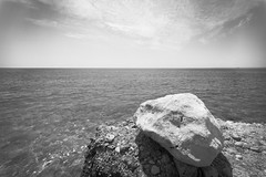 White Rock by Dark Sea (danliecheng) Tags: aegean turkey artistic attractions black blackandwhite clouds coast conditions dark destinations environment harsh lake landscape nature ocean rock rough sea seascape sky stone tough travel water weathered weathering white