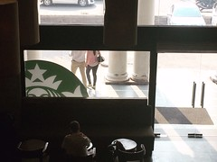 The Impressions of a Man Watching the Happy Lovers Leave the Bleak Island (Mayank Austen Soofi) Tags: delhi walla alone lonely connaught place starbucks cafe pair lovers loneliness solitude