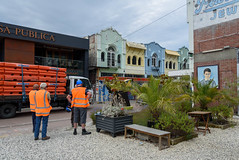 Where to Start First (Jocey K) Tags: newzealand christchurch buildings city signs architecture people street newregentst cafes chairs tables shops mural streetart painting artwork bench plants truck sky clouds