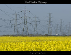 Pylon Pathway (Paul Simpson Photography) Tags: blue industry nature field yellow electric landscape countryside energy industrial bluesky pylon wires electricity naturalworld northlincolnshire photosof picturesof april2009 northlincs imagesof southhumberside paulsimpsonphotographyrapeseed