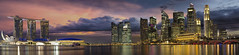 Singapore City Skyline at Sunset Panorama (JPLPhotographyPDX) Tags: city travel bridge sky panorama tourism skyline clouds marina buildings mouth river lights evening harbor office singapore downtown skyscrapers dusk district central bank stormy landmark business esplanade cbd nightlife hotels condominiums