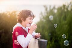 (angiel) Tags: boy sunset smile childhood fun happy happiness blowingbubbles bubblemix
