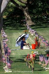Lady In the shade:Punchbowl Memorial Day, Hawaii (Julie Thurston) Tags: flowers coastguard choir canon army hawaii marine memorial cross heart pacific mayor waikiki senator flag cemetary salute rifle guard navy band trumpet americanflag flags lei wreath american hawaiian service marines honolulu horn airforce veteran wreaths services memorialday purpleheart veterans colorguard vets punchbowl tropicalflowers pyle nationalcemetery gunsalute armedservices nationalcemeteryofthepacific mayorcaldwell hawaiicolorguard memorialpunchbowlmemorial otrumpet puncbowlcemetery
