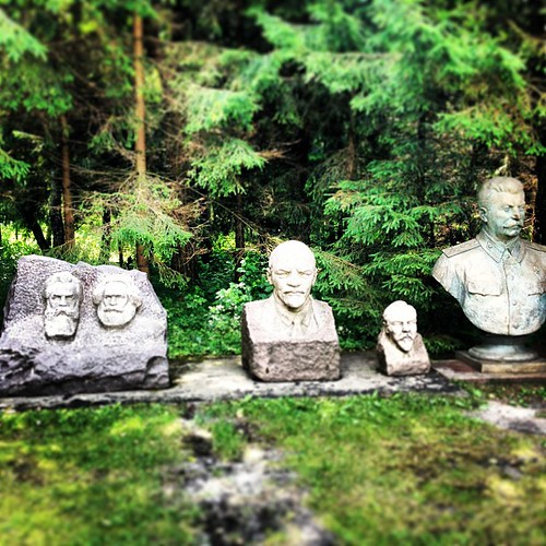 Off with their heads... At some fascinating park in Lithuania they're collecting former soviet statues. Here you can see Marx, Engels, Lenin, and Stalin. And some local communist leader in between.