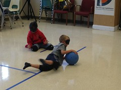"""BELL participants Jake and Aihua play good defense in a match of Goalball. • <a style=""""font-size:0.8em;"""" href=""""http://www.flickr.com/photos/29389111@N07/9544486382/"""" target=""""_blank"""">View on Flickr</a>"""