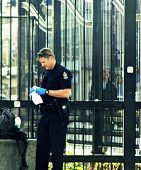 Blue Gloves of the Law (knightbefore_99) Tags: city blue west station vancouver corner work coast candid police drugs glove law grandview skytrain commercialdrive eastvan