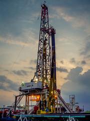 Oilfields Near Cepu (GlobalGoebel) Tags: sunset indonesia java olympus gas rig oil land pointandshoot drilling onshore oilandgas cepu