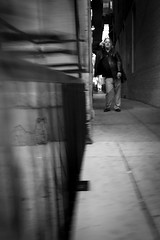 (319/366) Alley Conversation (CarusoPhoto) Tags: photography street monochrome white black bw blackandwhite talk conversation phone man alley neighborhood oldtown chicago carusophoto caruso john plus 7 iphone photo day project 365 366