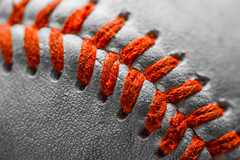 Stitched In Red  *Explore* (John Kocijanski) Tags: macro macromondays stitch red selectivecolor baseball sports canon60mmusmmacrolens bokeh