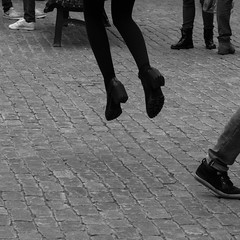Feet. (manganlundin) Tags: street streetphotography gamlastan stockholm blackandwhite jumping feet olympus omd 75 18