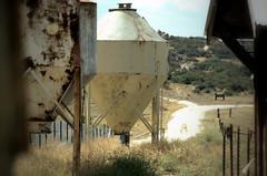 Abandon Silos (MORTradio) Tags: mortradio farming farm abandon rustedmetal rural inkscape gimp photoshop photoediting photoeffects indiansummer dirtroad livestock kansas nikon 5100