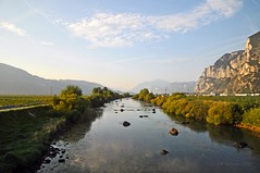 River in the valley (Vee living life to the full) Tags: italy leger travel touring holiday nikond300 heathaze view road sky cloud blue water light evening sunset sunrays sunburst lowlight highlight people travelling sleeping sun castle town village cloudformationsriver