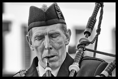 Piper (Frank Fullard) Tags: street ireland portrait bw musician music irish face mono candid pipes band parade mayo piper bagpipes castlebar fullard frankfullard
