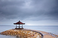 Balinese Pagoda (Matthew Post) Tags: bali seascape indonesia pagoda cloudy jetty stormy seawall boardwalk stonewall dyke tanjung benoa novotel