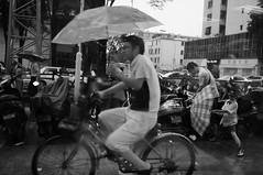 A rainy evening (A. adnan) Tags: china bw monochrome rain umbrella fuji father son parent rainy monsoon cycle raining unedited x100 sooc