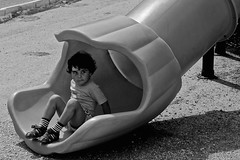 Kid (popaiulian1) Tags: street bw face photography 50mm blackwhite kid child sony slide romania a57