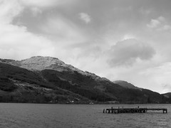 Loch Long, Arrochar, Scotland (Rebekka boo) Tags: wood old trip morning trees vacation blackandwhite bw cloud brown mountain black mountains tree nature water monochrome beautiful beauty clouds contrast dark landscape outdoors scotland pier countryside wooden big interesting long day waves break shadows country great memories monotone highlights calm boo filter journey shore april iphoto fujifilm daytime loch wreck tones bushes tone wrecked mothernature edit rebekka decrepid arrochar lochlong greatoutdoors fujifilmfinepix 2013 nationalholidays rebekkaboo rebekkabrown bekboo