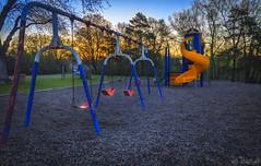 play (Saurav Kattel) Tags: morning orange minnesota sunrise lens colours child play bright slide swing mm 18135 canon60d
