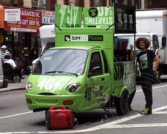 SIMPLE MOBILE 4G Vehicle on Broadway, Manhattan, New York City (jag9889) Tags: city nyc ny newyork green car advertising marketing manhattan broadway battery vehicle network threewheel 4g 2013 simplemobile jag9889