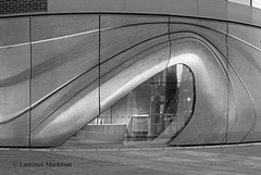 RocaGalleryLondon E W 057 BW (laurencemackman) Tags: lighting motion london glass station architecture buildings concrete bathroom lights chelsea exterior geometry contemporary railway fluid spanish elevation curved roca zahahadid futuristicarchitecture londonboroughofhammersmithandfulham zahahadidarchitects insituconcrete imperialwharf townmeadroad builtwork rocagallery rocagallerylondon norththamesgasworks