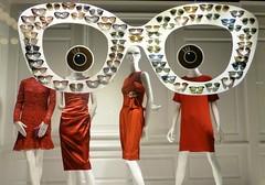 Red Eyes (KaDeWeGirl) Tags: newyorkcity red sun eye window glasses store dress manhattan explore saksfifthavenue weekly1472013