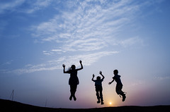 Bouncing kids !! (kailas bhopi) Tags: sunset silhouette kids fun jump jumping childrens 1855 childs bounce