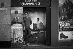 Built For Running (Leanne Boulton) Tags: monochrome urban street candid portrait streetphotography candidstreetphotography streetlife humour humorous juxtaposition fun funny man male face facial expression smoke smoker smoking cigarette doorway alcove hidden tone texture detail natural outdoor light shade shadow city scene human life living humanity people society culture canon 7d 50mm black white blackwhite bw mono blackandwhite glasgow scotland uk