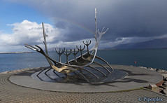 The Sun Voyager (Piperplex Photography) Tags: sony a6000 carl zeiss f28 12mm alpha rainbow sun voyager iceland reykjavik piperplex sea ocean sky cloud sculpture viking boat ship metal promenade