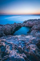 Cyprus, Agia Napa, Vathia Gonia (sebileiste) Tags: cyprus zypern agianapa vathiagonia sunset sonnenuntergang felsen steine stones rock bridge brcke long exposure sea mediterranean mittelmeer blau blue water orange sky himmel nikon d90 sigma kste coast