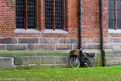 Bicycle Parking (breakfast_pizzas) Tags: transportation transport bicycle parking bicycleparking brick wall brickwall stone stonewall window windows outside grass green greengrass redbrick basket wheels wheel germany northerngermany northern north lubeck canon canon60d canonphotography europe outdoors flower flowers plant plants