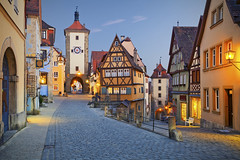 Rothenbourg (Voyages Lambert) Tags: nopeople dusk twilight cobblestone halftimbered streetlight illuminated medieval old famousplace architecture traveldestinations outdoors rothenburg franconia bavaria germany europe night clocktower house street fort tower cityscape town clock