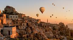 Journey to the Past (acipinarli) Tags: sky sunrise mountains travel light vacation flight colors fly panorama valley flying baloons hot air balloons anatolia cappadocia turkey uchisar