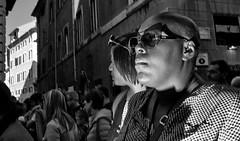 Focused. (Baz 120) Tags: candid candidstreet candidportrait city candidface candidphotography contrast street streetphoto streetcandid streetphotography streetphotograph streetportrait streetfaces rome roma romepeople romecandid romestreets monochrome monotone mono blackandwhite bw urban noiretblanc voigtlandercolorskopar21mmf40 life leicam8 leica primelens portrait people unposed italy italia girl grittystreetphotography flashstreetphotography faces flash decisivemoment strangers
