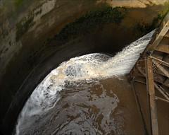 Squirting Muddy Water 2016. (Dave Whatt) Tags: mud squirting water lockgates lockpit splash composition brown wet