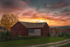 Sun sets on our flag. (Trotter Jay) Tags: flag americanflag usa americanpride flyingthecolors redbarn oldbarn rusticbarn scenicct countryside country landscapephotography nikond7100 birds flyingbirds sunset redsunset orangesunset yellowsunset warmsunset dramaticsky sky barn
