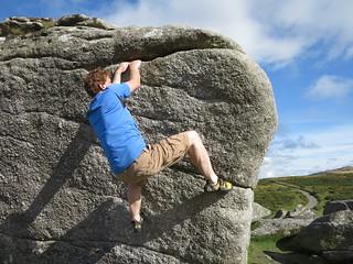 pulling up on boulder
