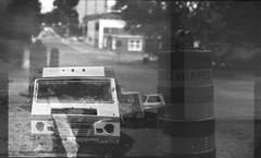 Canada to California to Pennsylvania (Maureen Bond) Tags: filmswap doubleexposure bw film canada california pennsylvania road trucks rv street buildings maureenbond phillipchee serendipity happyaccidents kb12