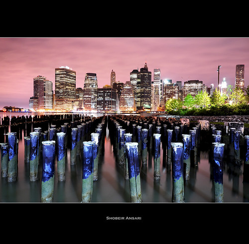 nyc newyorkcity longexposure ny newyork skyline brooklyn night skyscraper landscape downtown cityscape manhattan brooklynheights financialdistrict highrise eastriver newyorkskyline newyorkatnight brooklynbridgepark woodenpost sigma1020 nikond90 shobeiransari