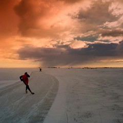 Speed skater immersing into the Dutch winter (Bn) Tags: gouwzee gouwsea ice skating markermeer monnickendam marken ijspret ijs iceskating thenetherlands holland iceskate schaatsen waterland elfstedentocht natuurijs ijstochten wintertime skatingonnaturalice dutchskaters schaatseninwaterland skateoutdoor schaats schaatsgekte elevencitiestour lakefreezeover bevrorenmeer nearamsterdam christmas volendam uitdam wijwillenijsvrij dutch tradition seaofice polders sneeuw snow skates koekenzopie speedskaters speedteams skatingtours frigidconditions cold winter hail hailing ijsoppervlakte dichtbevroren schaatsrijders schaatstocht ijsze genieten enjoy pleasure ijzers hagelbui sunshine darkclouds ben viking freeze badweather langebaanrijders noren klapschaatsen klapschaats skaters pootjeover 100faves topf50 topf100 50faves