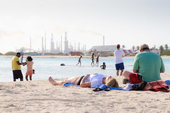Baby Beach in Aruba with Lago Refinery behind (Patrick J-st) Tags: sea people beach netherlands landscape island aruba caribbean antilles