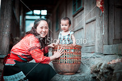 Mother-and-daughter-woman-from-chinese-yao-tribe (MPBHAIBO) Tags: china portrait people love childhood smiling horizontal female fun outdoors togetherness women day child adult daughter mother cheerful playful twopeople enjoyment 30s ethnicity  chineseculture  midadult  3035years  colorimage chinesewomen lookingatcamera 45years lowangleview  23years bamboobasket  familywithonechild  asianethnicity yaonationality yaotribe chineseethnicity