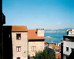 vigo 04 (hello, my name is cornelius) Tags: sea woman tree buildings harbor shadows roofs galicia ceaning cargosheep