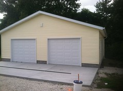 28' X 28' with 2- 9' X 7' Overhead Doors and a new Concrete Apron with Trough Drains
