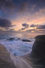 escape (ryanmccasland) Tags: sunset sun bird colors rock clouds landscape la san ryan wave diego jolla mccasland