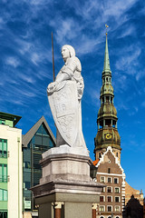 Sculpture of Roland in the town hall square in Riga (Viktor Descenko) Tags: old city travel sky sculpture building tower clock church monument st statue vertical architecture square town hall high europe european cathedral symbol famous capital gothic landmark baltic medieval latvia christian holy peter roland figure historical states riga latvian blackheads
