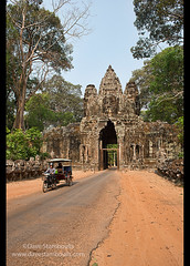Tuk tuk at the East Gate of Angkor Thom at Angkor Wat in Siem Reap, Cambodia (jitenshaman) Tags: travel art stone architecture asian temple gate asia cambodia khmer artistic angkorwat carving unesco temples destination tuktuk siemreap angkor passage unescoworldheritage entry eastgate basrelief angkorthom stonefaces angkorian jayavarman prasat worldlocations