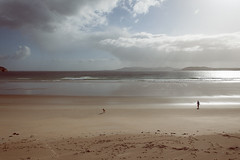 Dunfanaghy (zip po) Tags: morning ireland sky cloud dog beach sunshine silhouette lady landscape candid donegal dunfanaghy