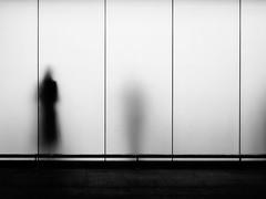 """Smoking Area"" (helmet13) Tags: leicaxvario bw people silhouette woman opalglasspane airport londonheathrow smokingarea aoi world100f heartaward peaceaward platinumpeaceaward gettyimages 300faves simplicity"