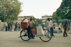 Ice bicycle seller! (Scalino) Tags: chandigarh india inde lecorbusier northindia lecorbusiercity modernarchitecture concrete brutalism ice wallah seller bycicle sikh turban posing sector17 bicycle